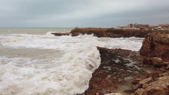Thumbnail for Crushing Waves Against Tall Rocks Along the Coastline.
