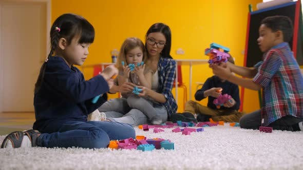 Thumbnail for Asian Little Girl Playing with Constructing Blocks