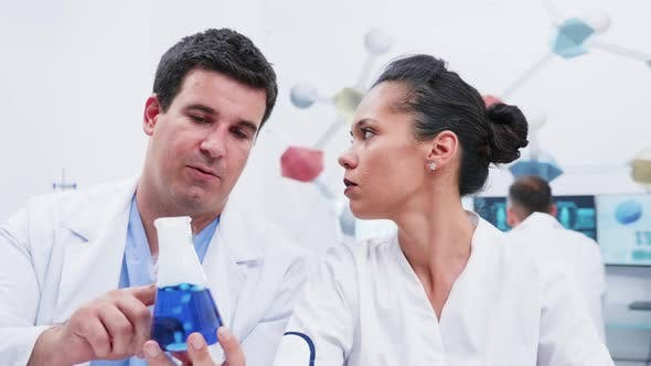 Revealing Shot of Male and Female Scientists in Modern Laboratory