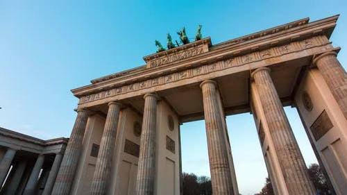 Hyper lapse of the Brandenburg Gate Berlin with blue sky and clouds