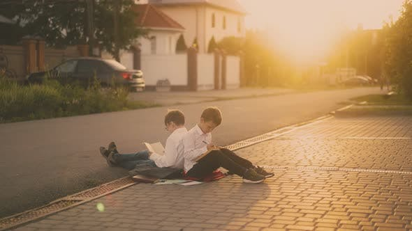 Thumbnail for students sitting on road prepare for exam against sunlight