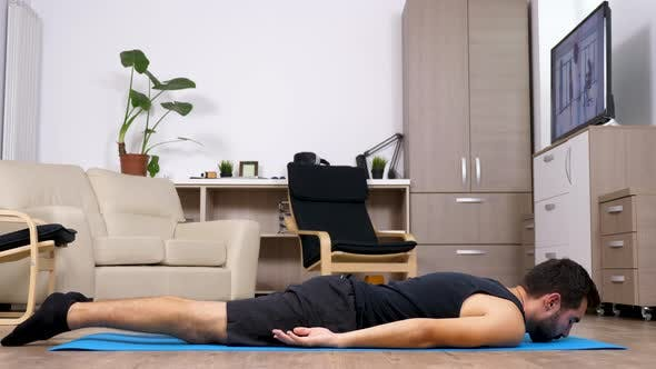 Thumbnail for Fit Man on a Blue Mat in His Living Room Does Different Yoga Poses