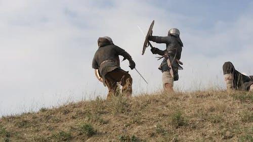 Medieval man defeating enemies
