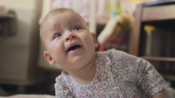 Thumbnail for Adorable Baby Girl Playing