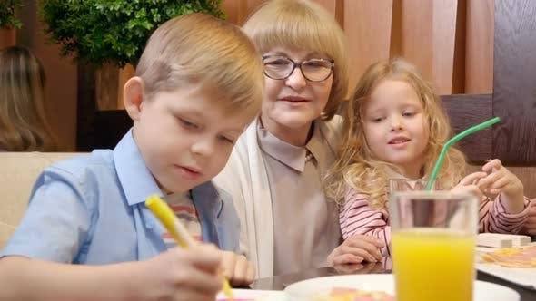 Thumbnail for Grandmother with Grandchildren at Cafe