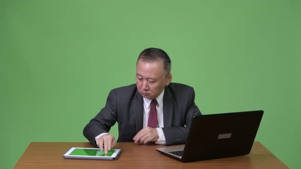 Thumbnail for Mature Happy Japanese Businessman Celebrating