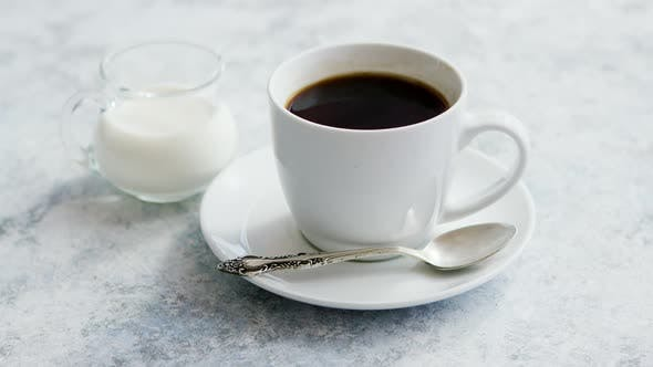 Thumbnail for Cup of Coffee and Pitcher of Milk
