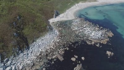 Aerial Shot of Coastline Bay with the Rocks and Cliffs