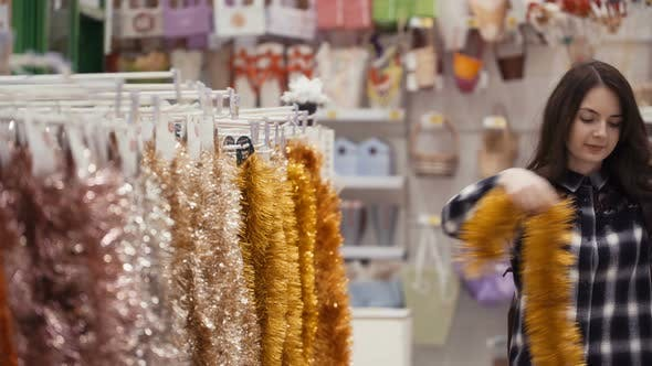 Thumbnail for Pretty Woman Buying Christmas Decorations