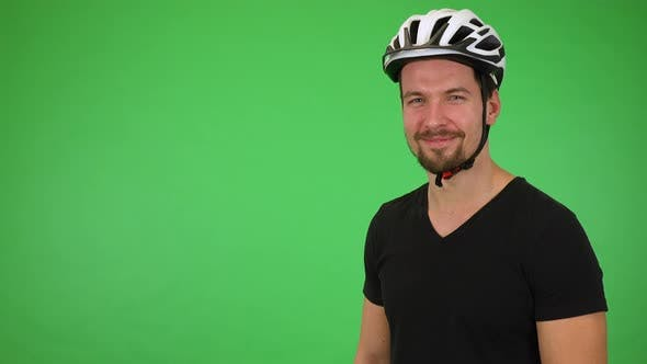 Thumbnail for A Young Handsome Cyclist Smiles at the Camera - Green Screen Studio