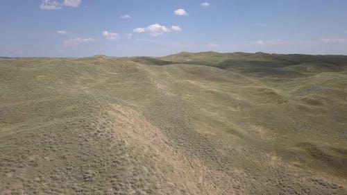 Pan of Wyoming Sand Dunes or Sandhills Prairie Rangeland in Summer
