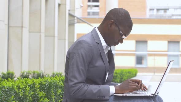 Thumbnail for African American Entrepreneur Displaying Computer Laptop On. Outdoors