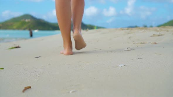 Thumbnail for Close Up Female Feet Walking Barefoot on Sea Shore at Sunset. Slow Motion.