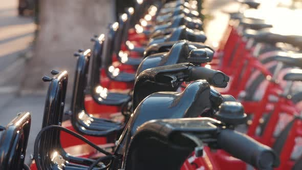 Thumbnail for BARCELONA, SPAIN - 25 JANUARY 2019: Row of Red Bicycles in a Bike Rack, Available for Rental on the