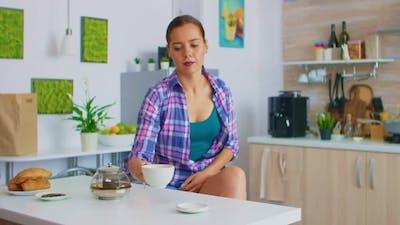 Lady Enjoying a Green Tea