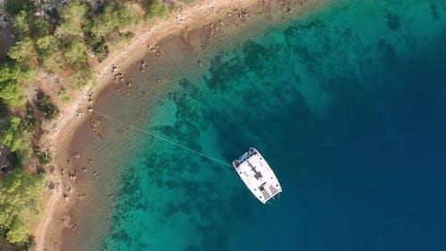 Aerial View of a Catamaran Yacht in the Blue Sea