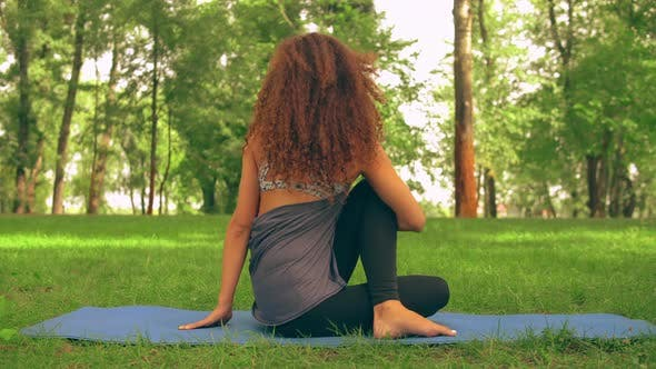 Thumbnail for Young Caucasian Girl Trains Yoga Outdoor