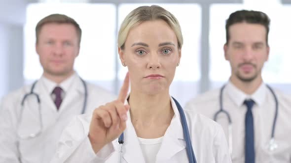Thumbnail for Portrait of Serious Female Doctor Saying No By Finger Sign