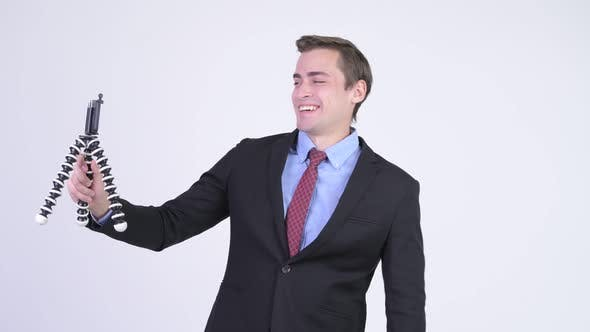 Cover Image for Young Happy Handsome Businessman Vlogging with Phone