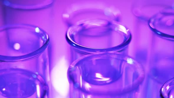 Thumbnail for In the Laboratory, the Scientist Analyzes the Colored Fluid in the Test Tube.