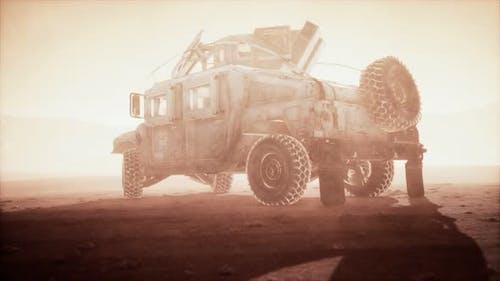 Military Patrol Car on Sunset in Desert Storm