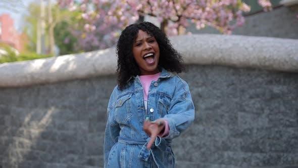 Thumbnail for Latin woman dancing in a city enjoying weekend