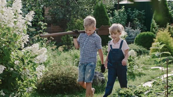 Thumbnail for Little Boy and Girl with Shovel in Garden