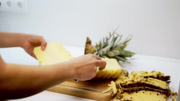 Thumbnail for Pineapple cut with knife. Close up view of cut the pineapple with knife