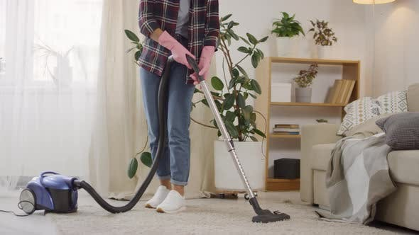 Thumbnail for Sequence of Woman Vacuuming in Living Room