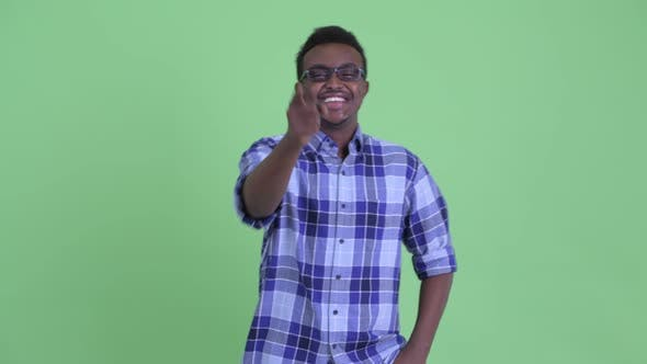 Thumbnail for Happy Young African Hipster Man Laughing and Pointing at Camera