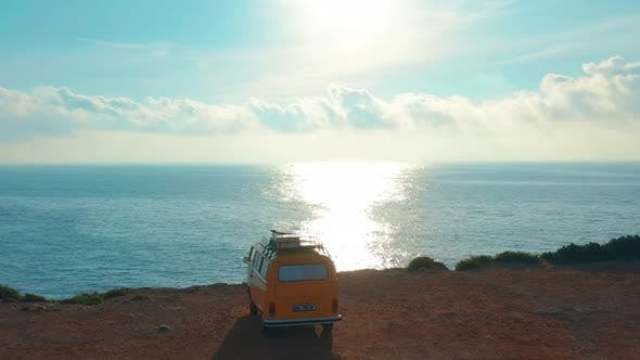 Thumbnail for California, United States, JULY 20TH, 2019: Aerial View. Yellow VW Bus Van on a Parking Lot on a