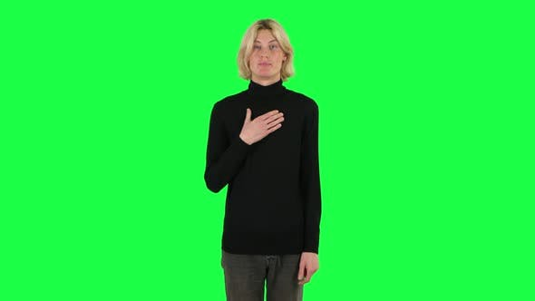 Cover Image for Blonde Guy Indignantly Talking To Someone, Looking at the Camera. Green Screen