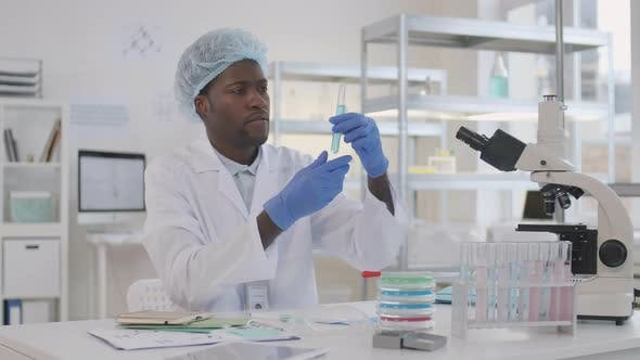 African Scientist Working in Lab