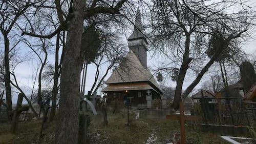 The Wooden Church and the cemetery, Oncesti