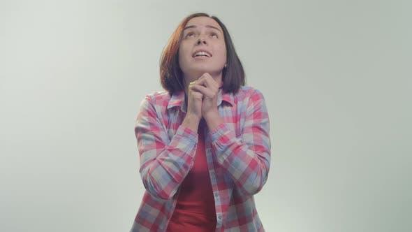 Thumbnail for A woman praying