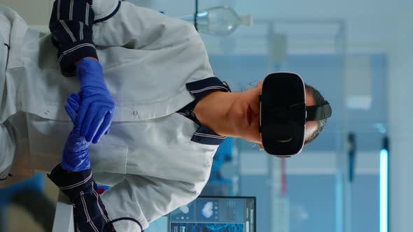 Vertical Video Professional Scientist Wearing Virtual Reality Glasses Using Medical Inovation in Lab