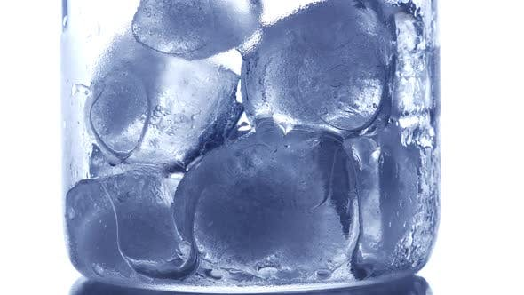 Ice Cubes Melting in Drinking Glass