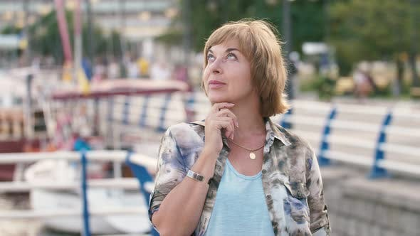 Thumbnail for Happy Blonde Woman Enjoying Skyscape and Riverscape on Dnipro Quay in Slo-mo