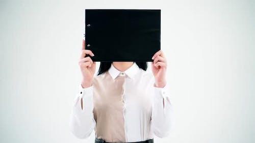 Black folder hides woman face