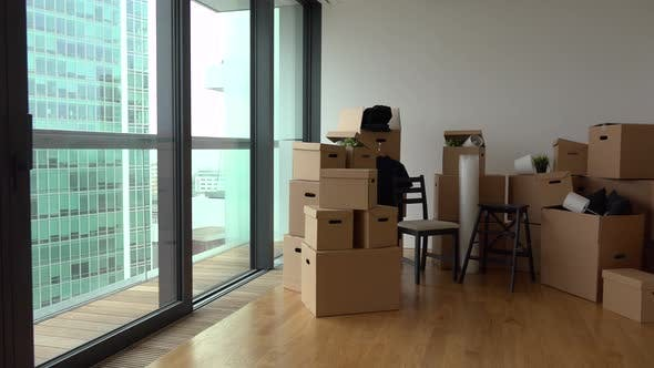 Thumbnail for Cardboard Boxes and Chairs in the Interior of an Apartment