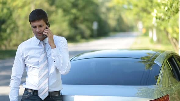 Cover Image for Serious Business Executive Communicating on Phone