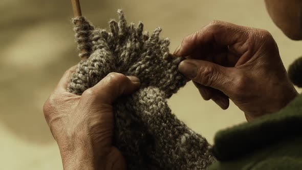 Thumbnail for Old Woman doing traditional Artisan Knitting. Slow Motion Shot.