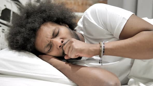 Cover Image for Coughing Sick African Man Sleeping in Bed, Cough
