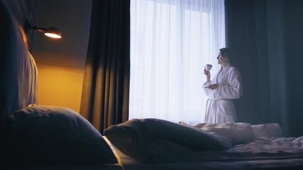 Thumbnail for Woman Drink Coffee in the Hotel Room