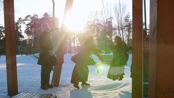 Thumbnail for Russian Folk - Woman in a Traditional Costume Is Riding on a Swing in a Winter Park