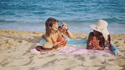 Two Best Girlfriends Relaxing on Sandy Beach