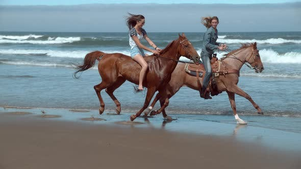 Super slow motion shot of women riding horses at beach, Oregon, shot on Phantom Flex 4K