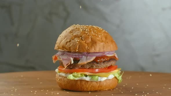 Thumbnail for White Sesame Seed Falling Into Bun in Slow Motion. Bun with Sesame for Making Hamburger