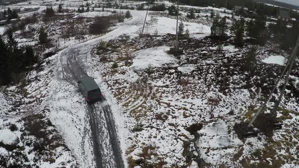 Car driving in northern town, aerial view