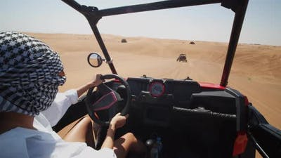 Woman Driving a Sand Dune Buggy in the Desert